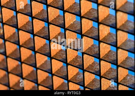 Rusty grid against a blue sky, background image, Germany - Stock Photo