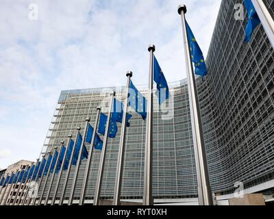 European flags in front of the Berlaymont building, headquarters of the European Commission, Europaviertel, Brussels, Belgium - Stock Photo