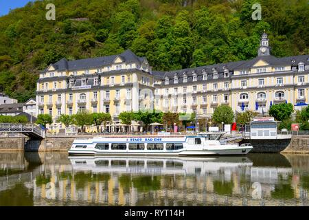 Passenger ship at mooring in front of Grand Hotel, Bad Ems an der Lahn, Rhineland-Palatinate, Germany - Stock Photo