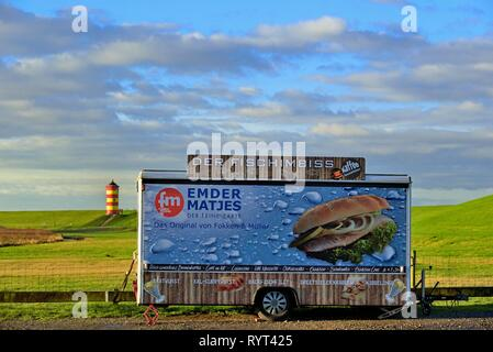 Closed fish snack car stands on the car park in front of the Pilsum lighthouse, Pilsum, East Frisia, Lower Saxony, Germany - Stock Photo