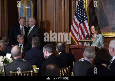 Washington, DC, USA. 14th Mar, 2019. United States President Donald J. Trump, left, and United States Senator Patrick Leahy (Democrat of Vermont), second left, listen to Speaker of the US House of Representatives Nancy Pelosi (Democrat of California), right, as she makes remarks during the Friends of Ireland luncheon with Leo Varadkar, Ireland's prime minister at the U.S. Capitol in Washington, DC, U.S., on Thursday, March 14, 2019. Credit: Olivier Douliery/Pool via CNP | usage worldwide Credit: dpa/Alamy Live News - Stock Photo