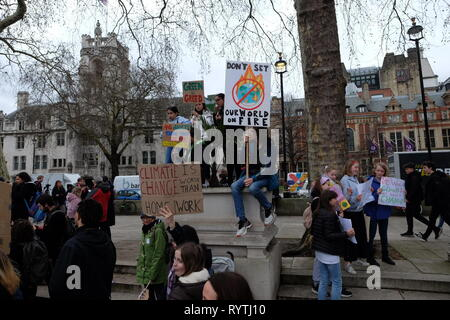 London, United Kinngdom - Friday 15 March 2019: Thousands of students and supporters gathered to picket on Parliament Square and The Departmnent for Business Energy and Industrial Strategy in support of Youth Strike 4 Climate. The #fridaysforfuture movement was started by Greta Thunberg, a 16 year-old Swedish Climate Activist and has gained momentum around the world. - Stock Photo