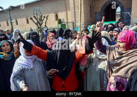 Kashmir, India. 15th Mar 2019. Supporters of top Kashmiri separatist leader Mirwaiz Umar Farooq shout pro-freedom slogans during the protest in Srinagar, Kashmir. Protests erupted in old city of Srinagar soon after congregational Friday prayers against NIA's summon to Kashmir's chief cleric and world renowned religious scholar Mirwaiz Umar Farooq for questioning in its ongoing probe into the terror funding case. Credit: SOPA Images Limited/Alamy Live News - Stock Photo
