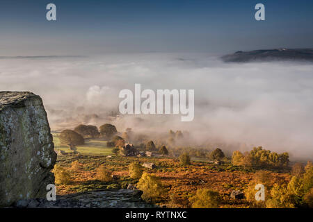 View from Curbar Edge, Derbyshire with autumn mist in the valley - Stock Photo