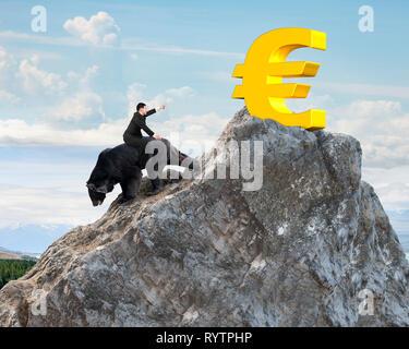 Businessman riding black bear pursuing gold euro symbol on mountain peak with sunlight clouds background. Fight back bearish market concept. - Stock Photo