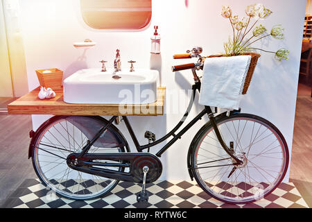 Washbasin and retro bicycle in the bathroom - Stock Photo