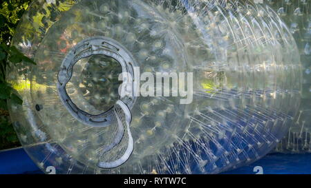 The transparent water zorb in standby it is an inflatable water fun activity for kids and adults - Stock Photo