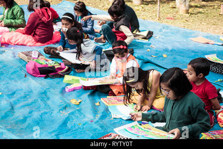 Kolkata, India, 10th March, 2019: Inter school students in a sit and draw competition on the occasion of spring festival. The kids were given task on  - Stock Photo