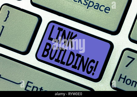 Handwriting text writing Link Building. Concept meaning Process of acquiring hyperlinks from other websites Connection Keyboard key Intention to creat - Stock Photo