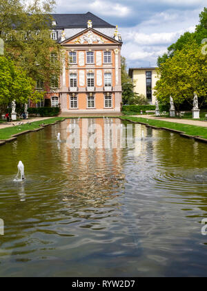 Electoral Palace with a pond in Trier, the oldest German city on a sunny April day - Stock Photo
