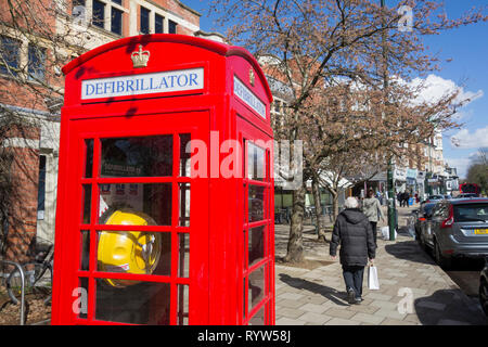 A converted Sir Giles Gilbert Scott K6 phone box now used to store a defibrillator in London, UK - Stock Photo