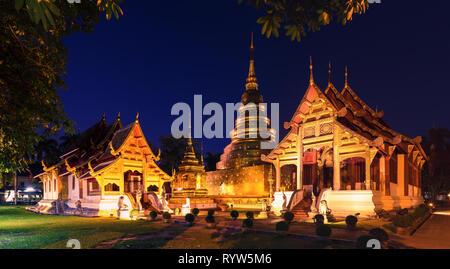 Wat Phra Singh at dusk, Chiang Mai, Thailand - Stock Photo