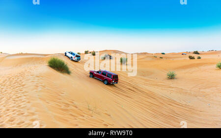 DUBAI, UNITED ARAB EMIRATES - DECEMBER 13, 2018: Jeeping in the desert. Copy space for text - Stock Photo