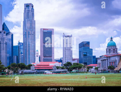 Singapore, Singapore - March 1, 2016: Skyline of One Raffles Place and UOB Building with Old Supreme Court and Victoria Theater and concert Hall  in S - Stock Photo