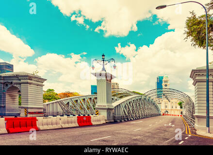 Singapore, Singapore - March 1, 2016: Anderson Bridge over Singapore River. Skyscrapers on background. - Stock Photo