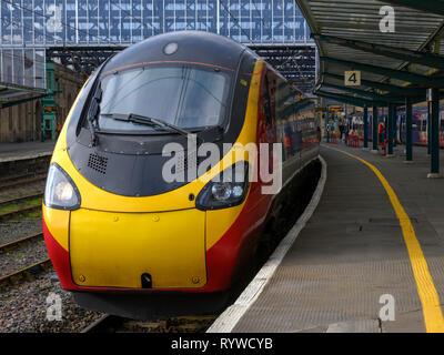 British Rail Class 390 Pendolino train in Virgin livery at Carlisle Citadel Railway Station, Carlisle, Cumbria, England, UK - Stock Photo