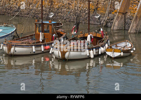 Pleasure craft and fishing boats moored in Minehead Harbour on the Somerset coast on a sunny day - Stock Photo