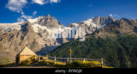 The Oratory of Le Chazelet at sunset with the peaks of La Meije and its glacier. Ecrins National Park, La Grave, Hautes-Alpes, European Alps, France - Stock Photo