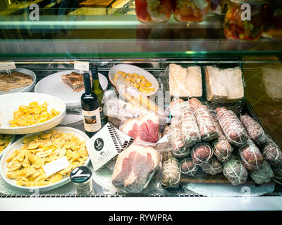 BERGAMO, ITALY - FEBRUARY 25, 2019: window of grocery shop with local gastronomy products in Citta Alta (Upper Town) of Bergamo city, Lombardy - Stock Photo
