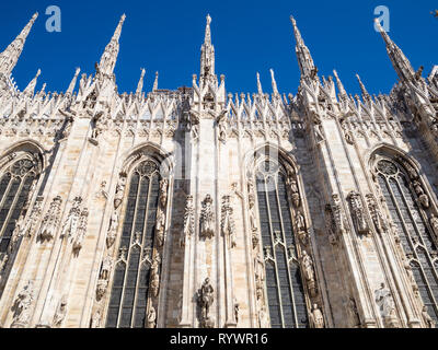 Travel to Italy - side view of wall of Milan Cathedral (Duomo di Milano) in Milan city in morning - Stock Photo