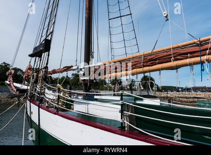 The bow of a wooden sailboat moored in Bar Harbor Maine. - Stock Photo