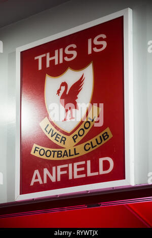 Red This is Anfield sign with team emblem on wall above entrance tunnel from players area onto pitch at Liverpool Football Club Anfield Road Stadium - Stock Photo