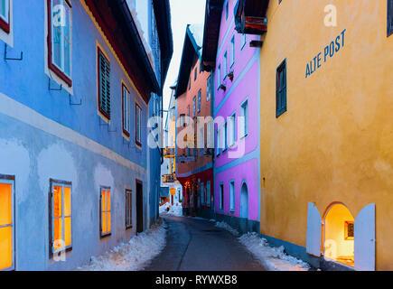 Hallstatt, Austria - January 29, 2019: Houses on Narrow street in Hallstatt near Salzburg in Austria, Europe. Winter, Salzkammergut. Travel to Austrian city at Christmas. - Stock Photo