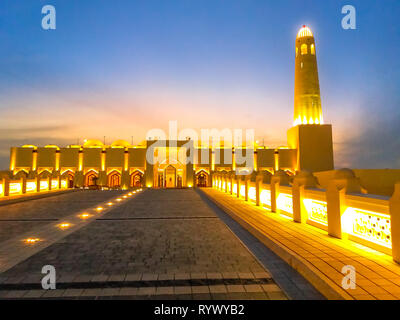 Lighted path towards State Grand Mosque illuminated at night in Doha Downtown, Middle East, Arabian Peninsula, Persian Gulf. Famous landmark in Doha - Stock Photo