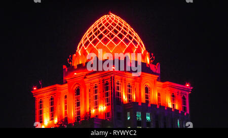 Doha, Qatar - February 18, 2019: details of West Bay Complex illuminated at night near Qatar International Exhibition Center and Diplomatic District - Stock Photo