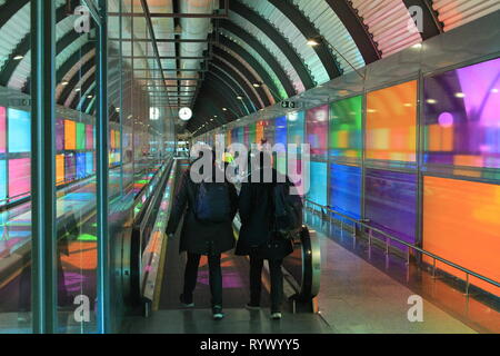 Travelers in the Adolfo Suarez Madrid-Barajas International Aiport, Madrid, Spain - Stock Photo