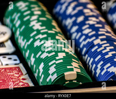 A poker scene with cards, chips and green felt.  Poker game, dark background. - Stock Photo