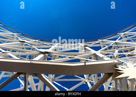 Looking up on a section of track from an amusement park roller coaster. - Stock Photo