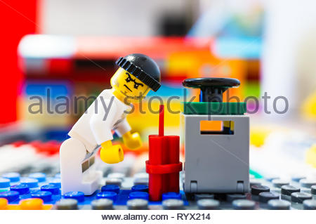 Poznan, Poland - March 14, 2019: Lego escaped prisoner tries to blow up a safe with dynamite. - Stock Photo