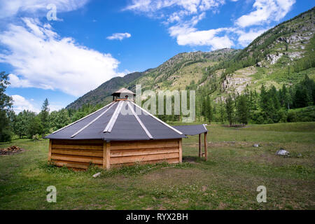 ail. Traditional Mongolian portable round tent ger covered with white outer cover in Altai Mountains of Western Mongolia. - Stock Photo