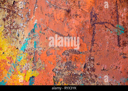 Old vintage metallic wall texture background, peeling cracked paint of different colors. Rusty weathered surface seamless pattern and abstract shapes. - Stock Photo