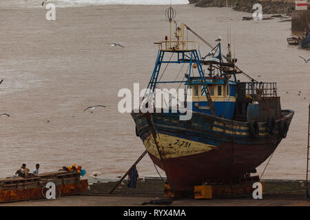 Closeup of big old fishing boat in drydock being repaired in Essaouira, Morocco - Stock Photo