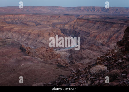 Aerial view of the deep, striated,  Fish River Canyon and river in Africa - Stock Photo