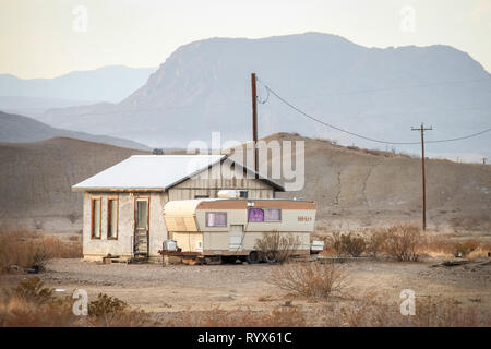 Landscape with caravan RV and small house in the Texas desert with electric cables - Stock Photo