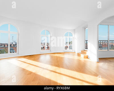 empty room in penthouse apartment flat with wooden floor - Stock Photo