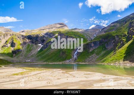 Alpine lake called Nassfeld Speicher in Hohe Tauern National Park in Austria - Stock Photo
