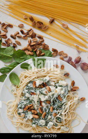 Pasta with spinach and cheese - Stock Photo