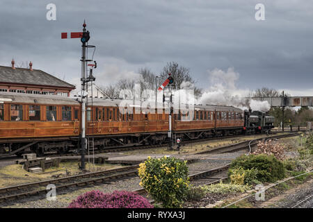 Landscape, side view of vintage steam train leaving Kidderminster SVR station pulled by two vintage UK steam locomotives double-heading at the front. - Stock Photo
