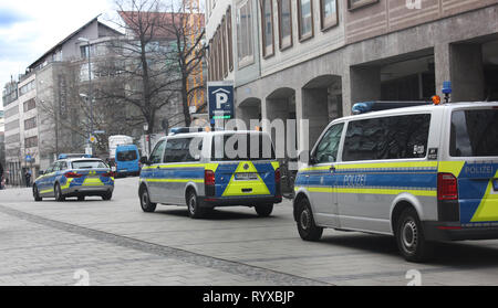 German blue-silver police cars, controlling the pedestrian area while carnival festivities in Munich, carneval Tuesday. - Stock Photo