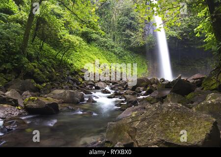 Beautiful Cascading Waterfall in Costa Rica Tropical Rainforest Jungle near La Fortuna in Arenal National Park - Stock Photo