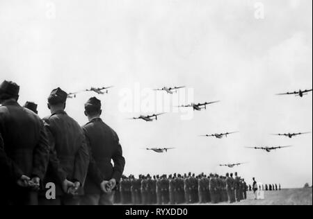 Personal photographs and memorabilia of fighting Americans during the Second World War. B-24 Liberator heavy bomber flyover parade. - Stock Photo