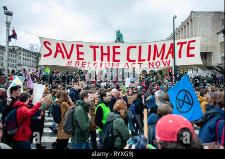 A huge banner is seen being held by demonstrators on the street during the Global climate strike for future rally. This Friday, tens of thousands of kids in more of 60 countries went on strike to demand climate change action. The school strike movement was inspired by Swedish teenager Greta Thunberg, who has been striking from school every Friday since last August to stand outside the Swedish parliament building and demand that her home country adheres to the Paris agreement on climate change. In Brussels, not just students, but teachers, scientists, and several syndicates took the streets of  - Stock Photo
