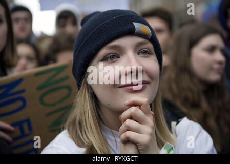 Warsaw, Mazowieckie, Poland. 15th Mar, 2019. A student seen smiling during the Earth Strike in Warsaw. Thousands of students and pupils skipped classes and marched through Warsaw to protest the climate change. Students demand action from politicians and adults in the matter of global warming. Protests were planned in more than hundred countries under the name of the Earth Strike movement. Credit: Attila Husejnow/SOPA Images/ZUMA Wire/Alamy Live News - Stock Photo