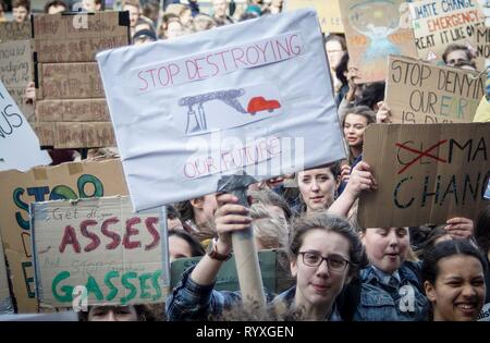 Sheffield, UK. 15th Mar, 2019. Students seen holding placards during the demonstration.Hundreds of students walk off their lessons as they head to the streets to demonstrate part of a global youth action over climate change. Credit: Ioannis Alexopoulos/SOPA Images/ZUMA Wire/Alamy Live News - Stock Photo