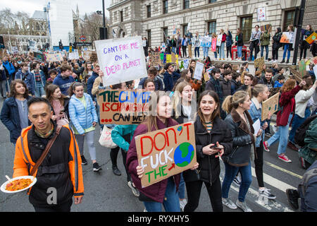 London, UK. 15th March, 2019. Thousands of students take part in the second Youth Strike 4 Climate. After gathering in Parliament Square, students marched to Buckingham Palace and then joined a protest by Extinction Rebellion which blocked Westminster Bridge. Credit: Mark Kerrison/Alamy Live News - Stock Photo