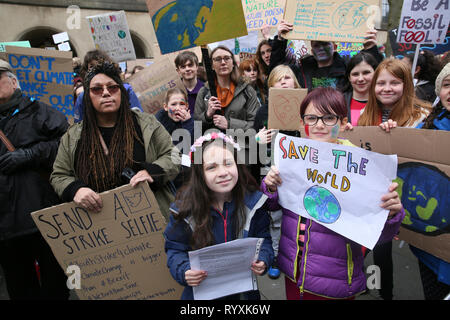 Manchester, UK, 15th March 2019. School students from across Manchester join a climate protest having walked out of school to coincide with actions taking place in other cities. Some of the protesting students blocked tram lines causing long delays on the metro link service. A small breakaway group took to the streets in an impromptu march and blocked Deansgate, a main route through the city, for a short period. Manchester, UK, 15th March 2019 (C)Barbara Cook/Alamy Live News Credit: Barbara Cook/Alamy Live News - Stock Photo